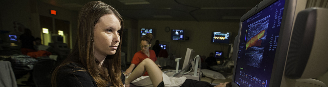Woman in Hospital Reviewing Sonogram