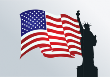 Statue of Liberty in front of US flag