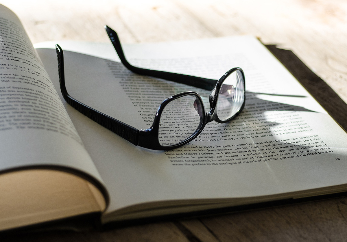 image of reading glasses on top of a book