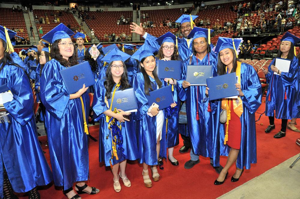 CSN students showing their diplomas