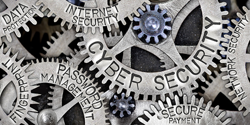 decorative image of wheel cogs with cybersecurity related words written on them