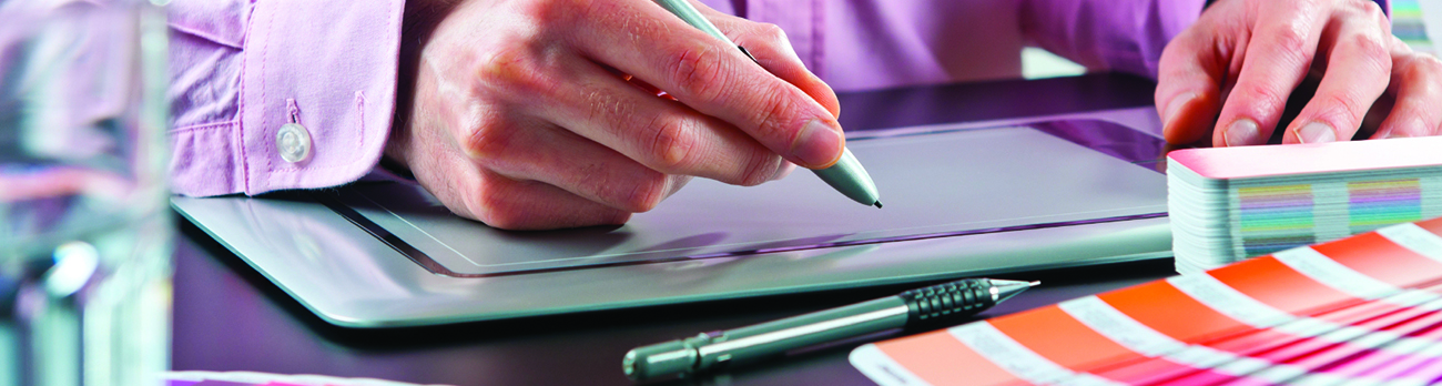 Close up of a person drawing on an electronic tablet