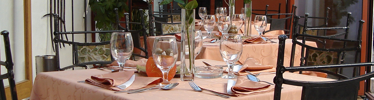 Three tables set with fine china and glassware