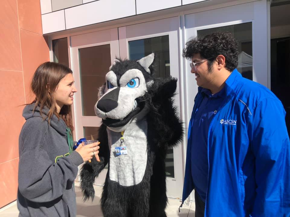 Cody the Coyote Mascot with students