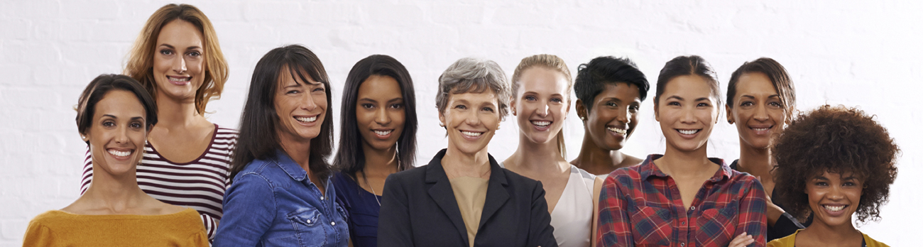 Ten ladies standing together, smiling for a picture