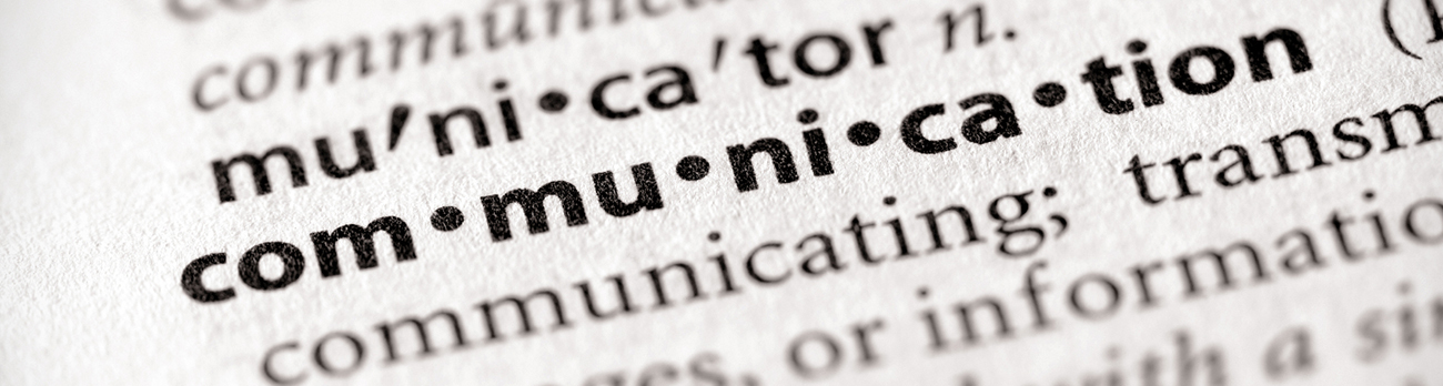 close up view of a dictionary page, showing the word Communication