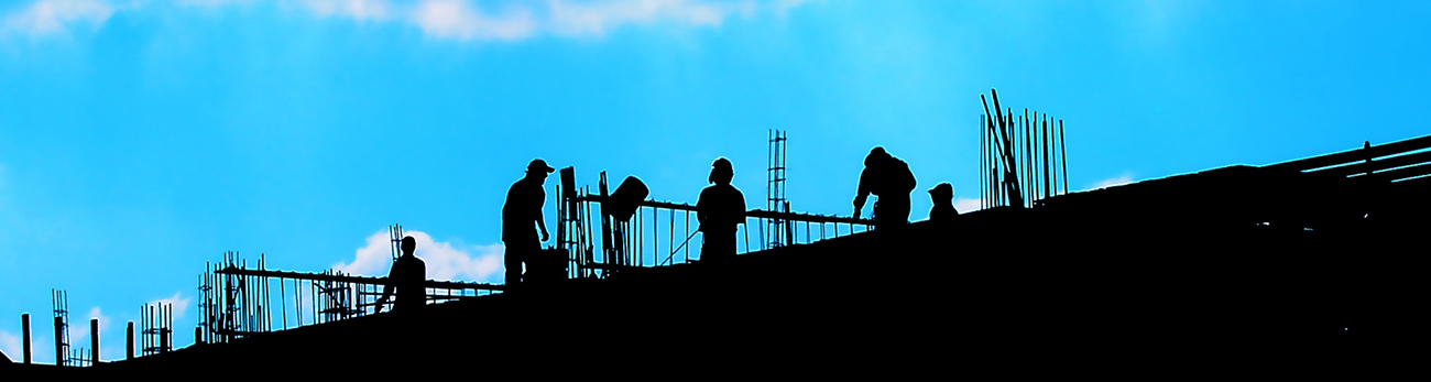 silhouettes of construction people working on a building