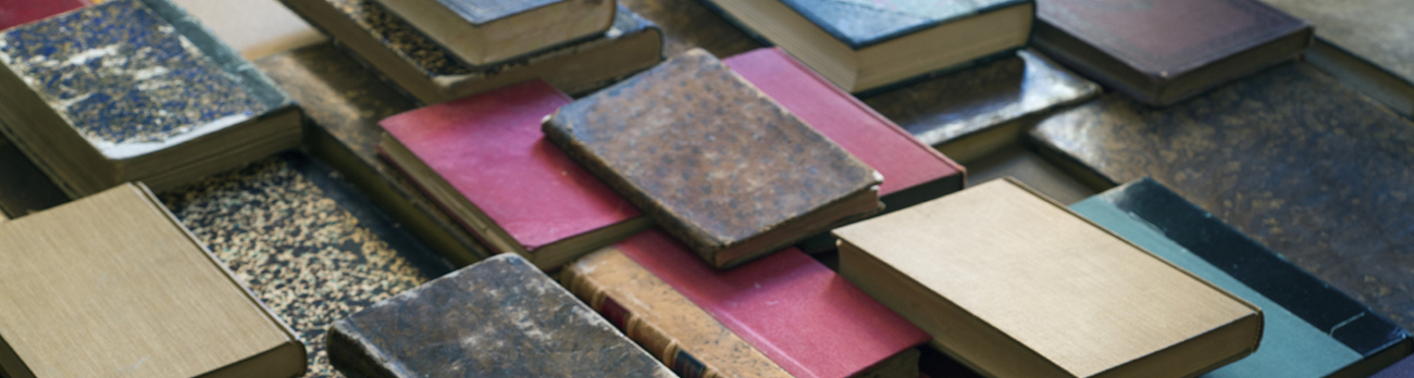 Assortment of books laid out on a table